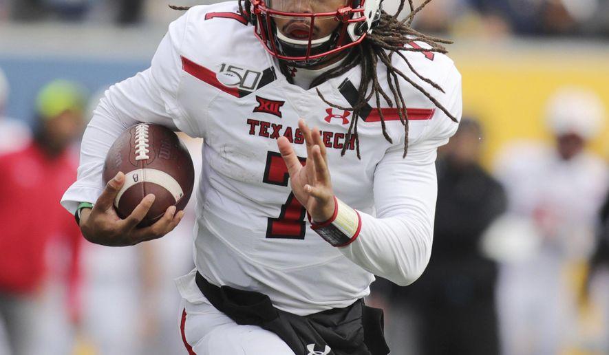 Texas Tech quarterback Jett Duffey (7) carries the ball near the goal line during the second quarter of their NCAA college football game against West Virginia in Morgantown, W.Va., Saturday, Nov. 9, 2019. (AP Photo/Chris Jackson)