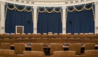 The House Ways and Means Committee hearing room, the largest hearing room in the House, is seen on Capitol Hill in Washington, Friday, Nov. 8, 2019. Rep. Adam Schiff, chairman of the House Intelligence Committee, will use this room to hold the first public session in its probe of whether President Donald Trump violated his oath of office by coercing Ukraine to investigate political rival Joe Biden and his family. (AP Photo/J. Scott Applewhite)