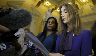 In this Feb. 21, 2019, file photo, Del. Charniele Herring, D-Alexandria, left, and House Minority Leader Eileen Filler-Corn, right, speak to the media at the rotunda inside the State Capitol in Richmond, Va. (Bob Brown/Richmond Times-Dispatch via AP, File)