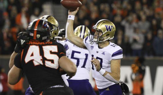 Washington quarterback Jacob Eason (10) throws a pass during the first half of the team's NCAA college football game against Oregon State in Corvallis, Ore., Friday, Nov. 8, 2019. (AP Photo/Amanda Loman)