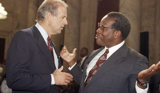 """I have no idea what he was talking about,"" Justice Clarence Thomas said of then-Sen. Joseph R. Biden, who chaired the Senate Judiciary Committee. His 1991 confirmation is detailed in ""Created Equal: Clarence Thomas In His Own Words."" (Associated Press)"