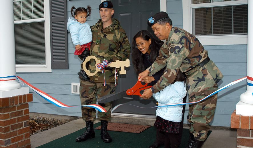 Retired Lt. Gen. Edward Soriano, then I Corps commanding general, along with an Army family, cut the ceremonial ribbon to dedicate the new 108-unit Beachwood II housing area on Lewis North, built under the Residential Communities Initiative in 2002. Photo by Mike Cullum, JBLM Enterprise Media Center.