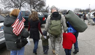 In this Dec. 24, 2011 file photo, Maj. Thomas Whipple walks to the car with his family following a ceremony at Fort Hood, Texas, for soldiers from the U.S. Army 1st Cavalry 3rd Brigade, who returned home from deployment in Iraq.  (AP Photo/Erich Schlegel, File) **FILE**