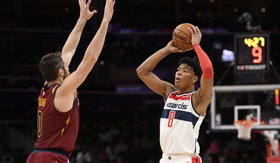 Washington Wizards forward Rui Hachimura (8), of Japan, holds the ball as Cleveland Cavaliers forward Kevin Love (0) defends during the first half of an NBA basketball game, Friday, Nov. 8, 2019, in Washington. (AP Photo/Nick Wass)