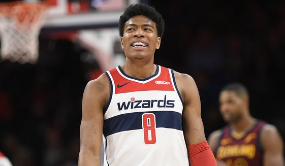 Washington Wizards forward Rui Hachimura (8), of Japan, reacts during the first half of an NBA basketball game against the Cleveland Cavaliers, Friday, Nov. 8, 2019, in Washington. (AP Photo/Nick Wass) ** FILE **