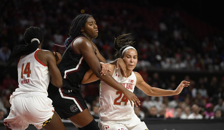 Maryland forward Stephanie Jones (24) and guard Diamond Miller (14) battle against South Carolina forward Aliyah Boston, center, for position during the second half of an NCAA college basketball game, Sunday, Nov. 10, 2019, in College Park, Md. South Carolina won 63-54. (AP Photo/Nick Wass)
