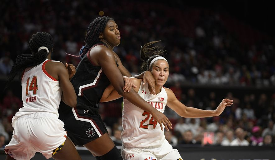 Maryland forward Stephanie Jones (24) and guard Diamond Miller (14) battle against South Carolina forward Aliyah Boston, center, for position during the second half of an NCAA college basketball game, Sunday, Nov. 10, 2019, in College Park, Md. South Carolina won 63-54. (AP Photo/Nick Wass) **FILE**