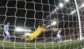 Liverpool's Sadio Mane, right, heads the ball to score his side's third goal during the English Premier League soccer match between Liverpool and Manchester City at Anfield stadium in Liverpool, England, Sunday, Nov. 10, 2019. (AP Photo/Jon Super)