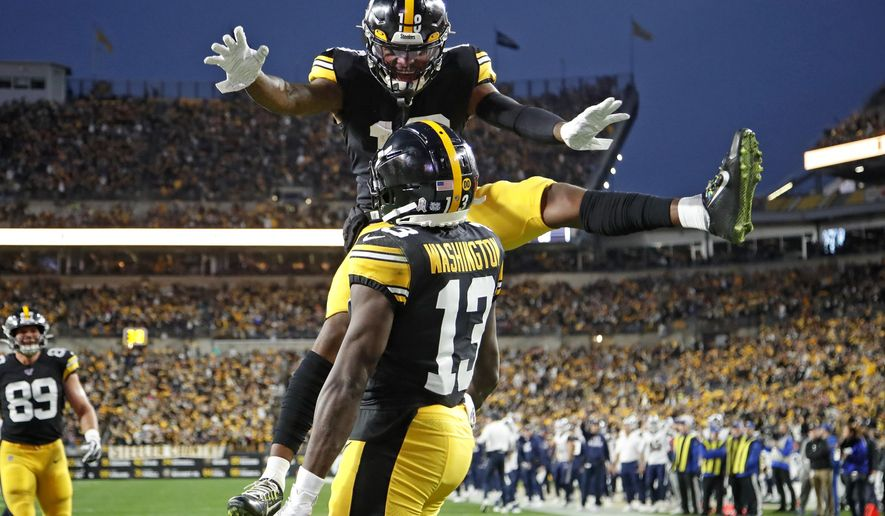 Pittsburgh Steelers wide receiver James Washington (13) celebrates his touchdown catch with Diontae Johnson (18) during the first half of an NFL football game against the LoLos Angeles Rams in Pittsburgh, Sunday, Nov. 10, 2019. (AP Photo/Don Wright)