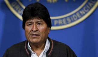 Bolivia's President Evo Morales looks on during a press conference in La Paz, Bolivia, Sunday, Nov. 10, 2019. Morales is calling for new presidential elections and an overhaul of the electoral system Sunday after a preliminary report by the Organization of American States found irregularities in the Oct. 20 elections. (AP Photo/Juan Karita)