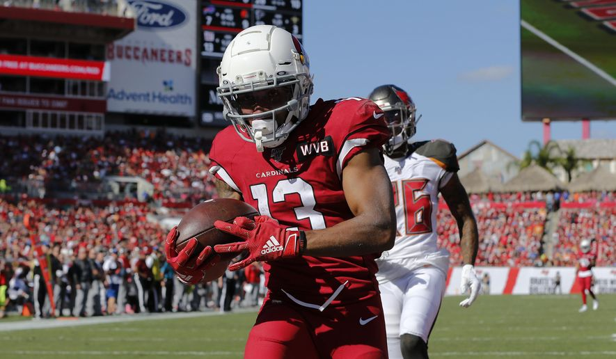Arizona Cardinals wide receiver Christian Kirk (13) pulls in a 33-yard touchdown pass in front of Tampa Bay Buccaneers cornerback M.J. Stewart (36) during the first half of an NFL football game Sunday, Nov. 10, 2019, in Tampa, Fla. (AP Photo/Mark LoMoglio)