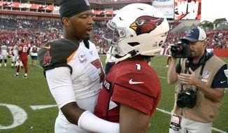 Tampa Bay Buccaneers quarterback Jameis Winston, left, talks to Arizona Cardinals quarterback Kyler Murray after an NFL football game Sunday, Nov. 10, 2019, in Tampa, Fla. (AP Photo/Jason Behnken)