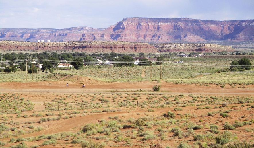 This June 17, 2019 photo provided by the Arizona Department of Water Resources shows the town of Fredonia, Ariz., from an earthen dam. The Fredonia dam is one of 16 high hazard dams in Arizona that an Associated Press investigation revealed to be in poor or unsatisfactory condition. (Arizona Department of Water Resources via AP)