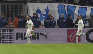 Marseille's Dimitri Payet celebrates scoring a penalty during the French League One soccer match between Marseille and Lyon at the Velodrome stadium in Marseille, southern France, Sunday, Nov. 10, 2019. (AP Photo/Daniel Cole)