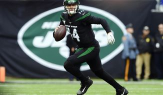 New York Jets quarterback Sam Darnold (14) runs during the first half of an NFL football game against the New York Giants, Sunday, Nov. 10, 2019, in East Rutherford, N.J. (AP Photo/Steven Ryan)
