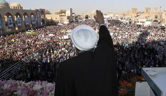 In this photo released by the official website of the office of the Iranian Presidency, President Hassan Rouhani waves to the crowd in a public gathering at the city of Yazd, some 410 miles (680 kilometers) southeast of the capital Tehran, Iran, Sunday, Nov. 10, 2019. Iran has discovered a new oil field in the country's south with over 50 billion barrels of crude oil,  Rouhani said Sunday, a find that could boost the country's proven reserves by a third as it struggles to sell energy abroad over U.S. sanctions. (Office of the Iranian Presidency via AP)