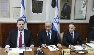 Israeli Prime Minister Benjamin Netanyahu center, Foreign Minister Israel Katz, left, and the government secretary Tzachi Braverman, attend the weekly cabinet meeting at the Prime Minister's office in Jerusalem, Sunday, Nov. 10, 2019. (Abir Sultan/Pool via AP)