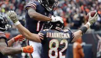 Chicago Bears tight end Ben Braunecker (82) celebrates his 18-yard touchdown reception with Anthony Miller (17) during the first half of an NFL football game against the Detroit Lions in Chicago, Sunday, Nov. 10, 2019. (AP Photo/Charles Rex Arbogast)