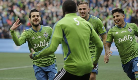 Seattle Sounders' Victor Rodriguez, left, celebrates with teammates after scoring against the Toronto FC, Sunday, Nov. 10, 2019, during the second half of the MLS Cup championship soccer match in Seattle. (AP Photo/Ted S. Warren)