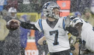 Carolina Panthers' Kyle Allen throws during the second half of an NFL football game against the Green Bay Packers Sunday, Nov. 10, 2019, in Green Bay, Wis. The Packers won 24-16. (AP Photo/Mike Roemer)