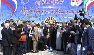 FILE - In this Sept. 10, 2016 file photo, released by official website of the office of the Iranian Senior Vice-President, the head of Russia's federal atomic agency Sergey Kiriyenko breaks ground in a ceremony to begin building Iran's second nuclear power plant, in the southern port city of Bushehr, Iran. On Sunday, Nov. 10, 2019, Iran's state TV reported that construction has begun on a second nuclear power reactor at its Bushehr plant amid heightened tensions over Tehran's collapsing nuclear deal with world powers. Bushehr's first reactor came online in 2011 with the help of Russia. This new reactor similarly will be built with Russian help. (Iranian Senior Vice-President's Office via AP, File )