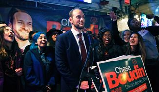 In this Tuesday, Nov. 5, 2019, photo, San Francisco District Attorney candidate Chesa Boudin pauses during his speech at an election night event at SOMA StrEat Food Park in San Francisco. Boudin, the son of anti-war radicals sent to prison for murder when he was a toddler, has won San Francisco's tightly contested race for district attorney after campaigning to reform the criminal justice system. (Scott Strazzante/San Francisco Chronicle via AP)