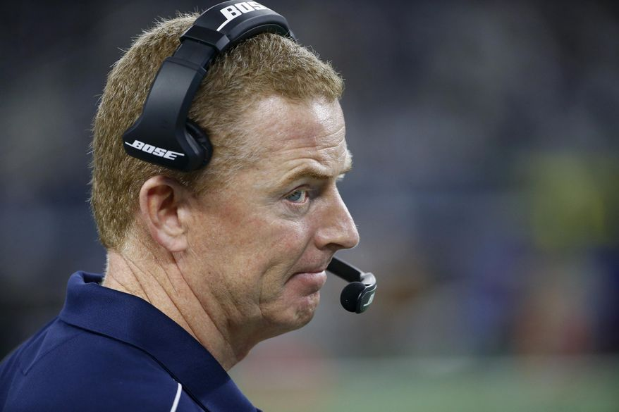 Dallas Cowboys coach Jason Garrett stands on the sideline watching play against the Minnesota Vikings during the first half of an NFL football game in Arlington, Texas, Sunday, Nov. 10, 2019. (AP Photo/Ron Jenkins)