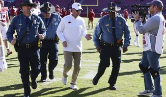 Arkansas coach Chad Morris heads to the locker room after the Razorbacks' 45-19 loss to Western Kentucky in an NCAA college football game, Saturday, Nov. 9, 2019, in Fayetteville, Ark. (AP Photo/Michael Woods)