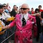 "Don Cherry, announcer on CBC's ""Hockey Night in Canada,"" is greeted by fans as he arrives for Game 2 of the NHL hockey Stanley Cup finals between the Pittsburgh Penguins and the Detroit Red Wings in Detroit, Sunday, May 31, 2009. (AP Photo/Carlos Osorio) **FILE**"