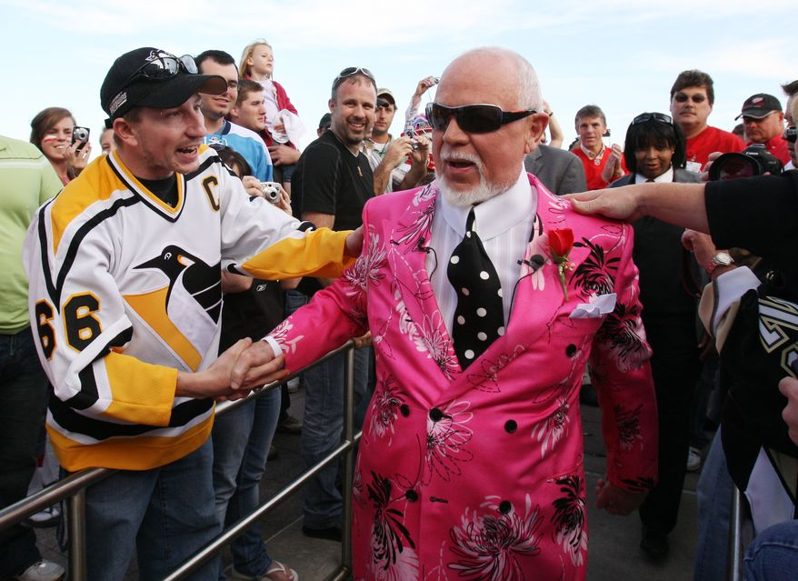 """Don Cherry, announcer on CBC's """"Hockey Night in Canada,"""" is greeted by fans as he arrives for Game 2 of the NHL hockey Stanley Cup finals between the Pittsburgh Penguins and the Detroit Red Wings in Detroit, Sunday, May 31, 2009. (AP Photo/Carlos Osorio) **FILE**"""