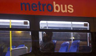A man sits alone inside a Metrobus in downtown Washington, Wednesday, March 16, 2016.  (AP Photo/Pablo Martinez Monsivais) **FILE**