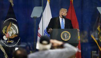 President Donald Trump speaks before the New York City Veterans Day Parade at Madison Square Park in New York, Monday, Nov. 11, 2019. (AP Photo/Seth Wenig)