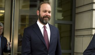 In this Feb. 23, 2018 file photo, Rick Gates leaves federal court in Washington. (AP Photo/Jose Luis Magana)