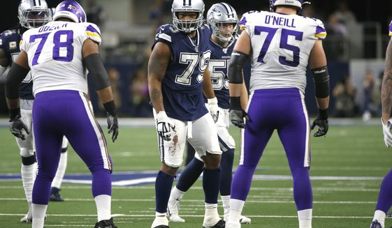 Dallas Cowboys defensive end Michael Bennett (79) looks on against the Minnesota Vikings in an NFL football game in Arlington, Texas, Sunday, Nov. 10, 2019. (AP Photo/Ron Jenkins) ** FILE **