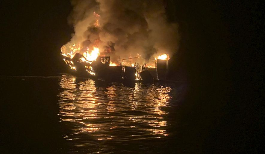 FILE - In this Sept. 2, 2019, file photo provided by the Santa Barbara County Fire Department, the dive boat Conception is engulfed in flames after a deadly fire broke out aboard the commercial scuba diving vessel off the Southern California Coast. The widow of Justin Dignam, one of the 34 people who died in the fire, has filed a lawsuit against the boat's owners, making it the first claim from one of the 34 victims' families. (Santa Barbara County Fire Department via AP, File)