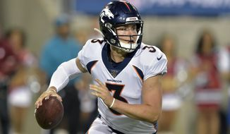 FILE - In this Aug. 1, 2019, file photo, Denver Broncos quarterback Drew Lock scrambles during the second half of the Pro Football Hall of Fame NFL preseason game against the Atlanta Falcons in Canton, Ohio. The Broncos are bringing rookie quarterback Lock back to practice Tuesday, Nov. 12, 2019, to see if he is going to be able to play this season. (AP Photo/David Richard, File)