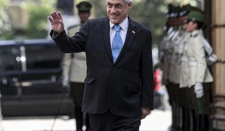 Chile's President Sebastian Pinera arrives to La Moneda presidential palace in Santiago, Chile, Monday, Nov. 11, 2019. The government announced Sunday it has agreed to write a new Constitution for the country, one of the most repeated demands of protesters who have taken to the streets in often violent demonstrations in recent weeks. (AP Photo/Esteban Felix)