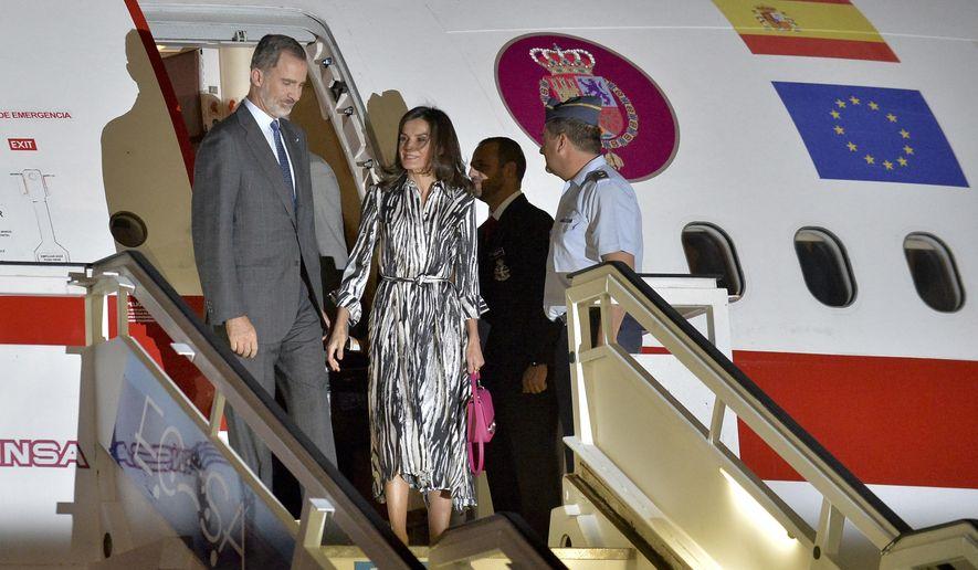 Spain's King Felipe VI and Queen Letizia arrive at the Jose Marti International airport in Havana, Cuba, Monday, Nov. 11. Spanish kings are in Havana in an official visit. (Yamil Lage/Pool photo via AP)