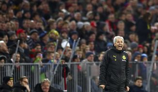 Dortmund's head coach Lucien Favre gives instructions to his players during the German Bundesliga soccer match between FC Bayern Munich and Borussia Dortmund, in Munich, Germany, Saturday, Nov. 9, 2019. (AP Photo/Matthias Schrader)