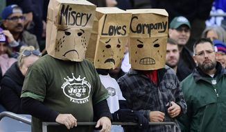 New York Jets fans watch the second half of an NFL football game against the New York Giants, Sunday, Nov. 10, 2019, in East Rutherford, N.J. (AP Photo/Steven Ryan)