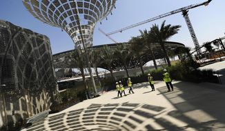 FILE - In this Oct. 8, 2019 file photo, the Sustainability Pavilion at the site of Expo 2020, which is under construction, is visited during a tour arranged for Associated Press journalists, in Dubai, United Arab Emirates. Israel's commissioner to Expo 2020 in Dubai says next year's world fair offers the country an opportunity to present a fresh face to the Arab world. (AP Photo/Kamran Jebreili, File)