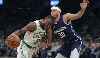 Boston Celtics guard Kemba Walker (8) drives to the basket against Dallas Mavericks guard Seth Curry (30) during the first quarter of an NBA basketball game in Boston, Monday, Nov. 11, 2019. (AP Photo/Charles Krupa)