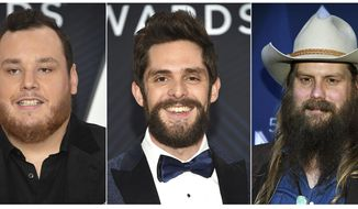 This combination photo shows, from left,  Dierks Bentley, Luke Combs, Thomas Rhett, Chris Stapleton and Keith Urban who are up for the Male Vocalist of the Year category at the Country Music Association Awards on Wednesday. (AP Photo)
