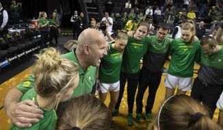 Oregon head coach Kelly Graves, center left, brings his team together before an NCAA college basketball game against Northeastern in Eugene, Ore., Monday, Nov. 11, 2019. (AP Photo/Chris Pietsch)