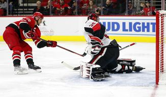 Carolina Hurricanes' Sebastian Aho (20), of Finland, shoots the puck past Ottawa Senators goaltender Anders Nilsson (31) for a goal during the second period of an NHL hockey game in Raleigh, N.C., Monday, Nov. 11, 2019. (AP Photo/Karl B DeBlaker)