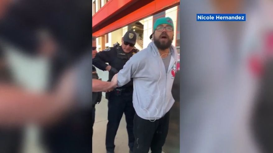 """Dozens of protesters staged an """"eat-in"""" on a San Francisco train platform on Sunday after a video of a black man being detained by police for eating a sandwich went viral. (KGO-TV)"""
