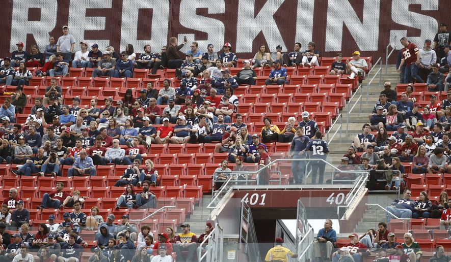 Fans watch play between the Washington Redskins and the New England Patriots during the second half of an NFL football game, Sunday, Oct. 6, 2019, in Landover, Md. (AP Photo/Patrick Semansky) **FILE**