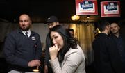 Hyeok Kim, left, a chair for WA Fairness, watches for early results at an election night party for supporters of Referendum 88, Tuesday, Nov. 5, 2019, in Seattle. Voters were deciding whether one's minority status should be considered as a contributing factor in state employment, contracting and admission to public colleges and universities. (AP Photo/Elaine Thompson)