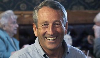 In this Sept. 19, 2019, file photo, Republican presidential candidate, former South Carolina Gov. Mark Sanford, smiles as he talks with customers at the Puritan Backroom restaurant, during a campaign stop in Manchester, N.H. (AP Photo/Elise Amendola)