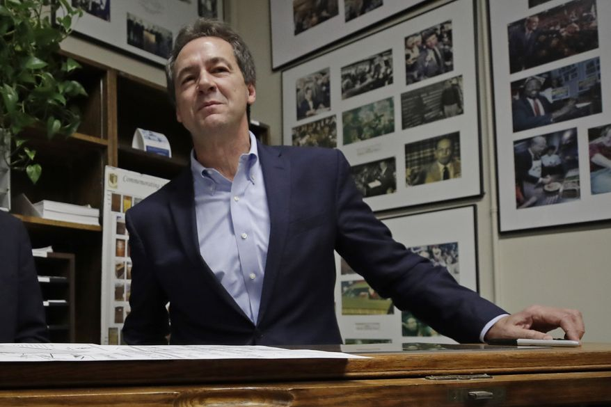 Democratic presidential candidate Montana Gov. Steve Bullock speaks to media after filing to be placed on the New Hampshire primary ballot at the Statehouse, Tuesday, Nov. 12, 2019, in Concord, N.H. (AP Photo/Elise Amendola) ** FILE **